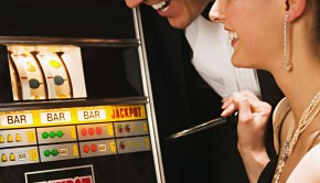 Couple playing on a fruit machine